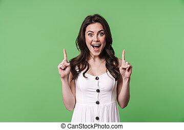 beeld, vrouw, omhoog, vingers, het glimlachen, verwonderd, kaukasisch, wijzende