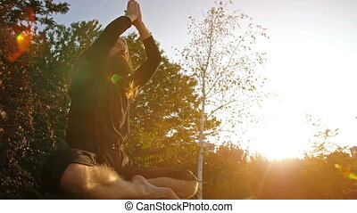 bidden, ondergaande zon , yogi