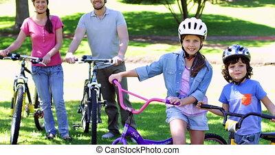 bike rit, park, het glimlachen, gezin