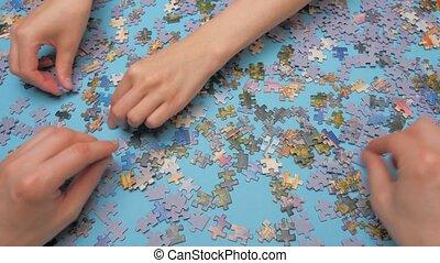 blauwe , oppervlakte, raadsels, handen, succesvolle , education., groep, spel, raadsel, preschool, aan het binden, achtergrond., concept., gezin, tijdverdrijf, work.