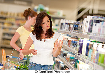 bruine , vrouw winkelen, reeks, -, haar, de afdeling van schoonheidsmiddelen
