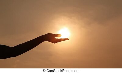 compresses, silhouette, zon, houden, hand, unclenches, palm, fist, palm