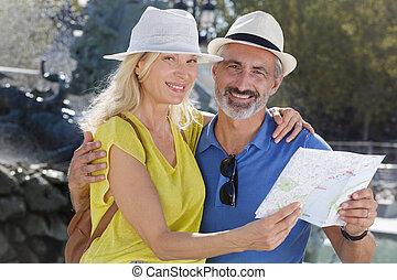 gebruik, stad kaart, paar, middelbare leeftijd