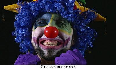 gekke , hilarious, jonge, clown, gezichten, vervaardiging