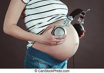 headphones., zwangere , muziek, pens, woman., luisteren