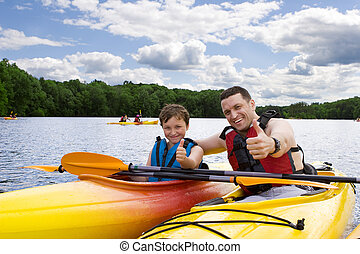 het genieten van, kayaking, vader, zoon