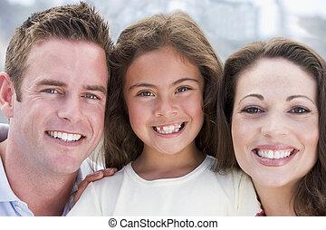 het glimlachen, gezin, buitenshuis