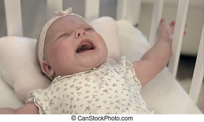 het schreeuwen van de baby, bed