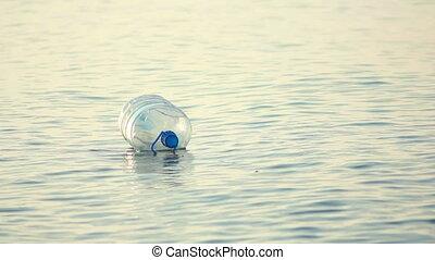 het slingeren, fles, golven