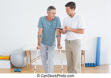 invalide, het bespreken, therapist, patiënt, rapporten