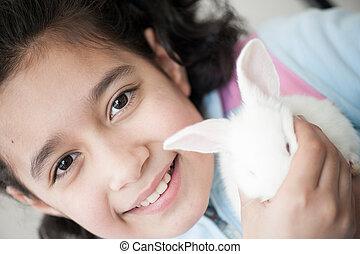 klein meisje, konijn