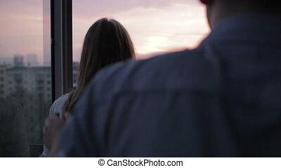 koppel zonsondergang, jonge, balkon