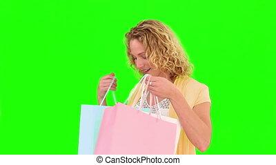 krullend, blonde , zakken, shoppen , holind, haired, vrouw