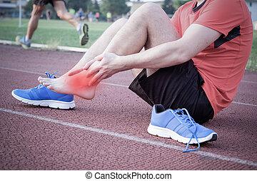 loper, enkel, hardloop wedstrijd, verwond