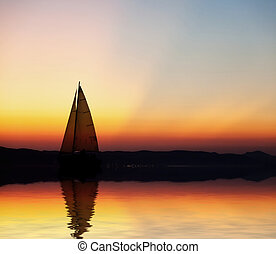 ondergaande zon , zeilboot