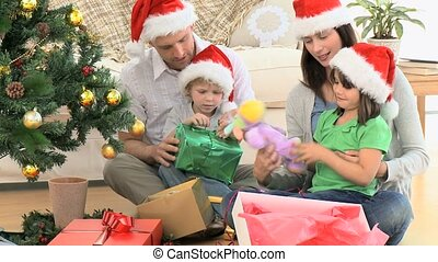 opening, kerstmis, gezin, cadeau