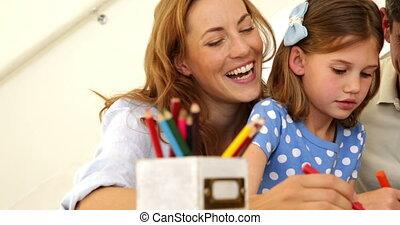 ouders, vrolijke , dochter, het verkleuren