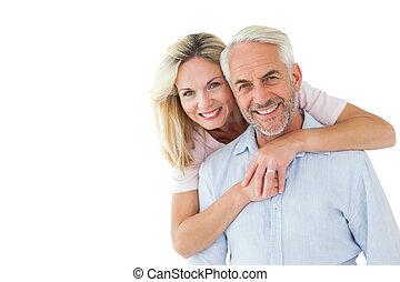 paar, het kijken, het glimlachen, omhelzen, fototoestel