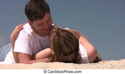 paar, het leggen, zand