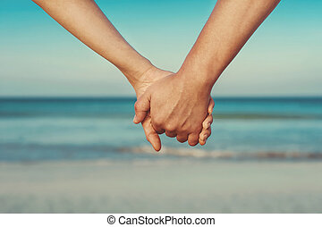 paar, minnaars, holdingshanden