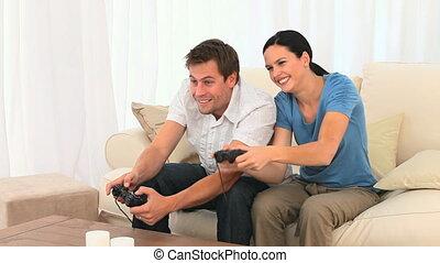 paar, spelen samen, videogames, jonge
