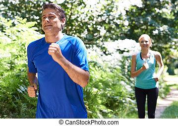platteland, paar, rennende , middelbare leeftijd