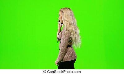 screen., klesten, groene, blonde , telefoon., meisje, zijaanzicht