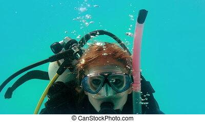 scuba-uitrustingstoestel, het kijken, fototoestel, vrouw