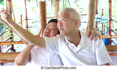 selfie, gelukkig paar, senior, aziaat