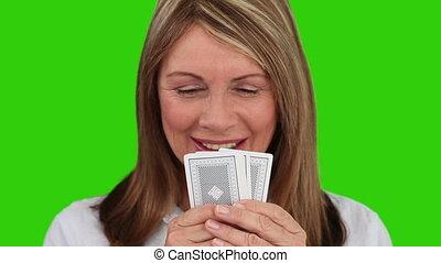 spelend, oudere vrouw, kaarten