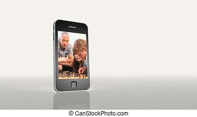 spelend schaakspel, video's, gezin