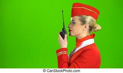 spreekt, screen., groene, stewardess, talkie., walkie, zijaanzicht