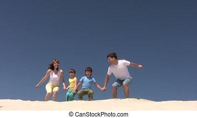 springt, zand, gezin