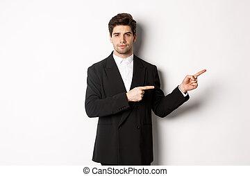 staand, achtergrond, kostuum, rechts, tegen, richtende vingers, zakenman, het kijken, witte , black , fototoestel, beeld, mooi