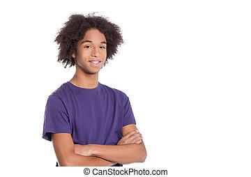 staand, jongen, tiener, het behouden, vrijstaand, armen, teenager., zeker, terwijl, gekruiste, afrikaan, het glimlachen, witte