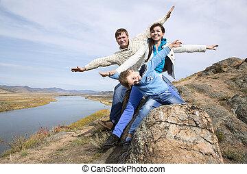 steen, gelukkige familie, zittende