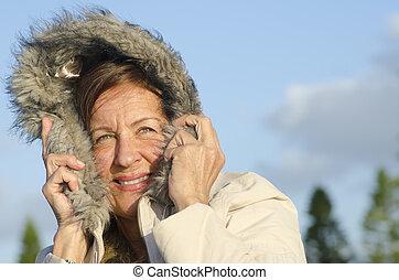 verticaal, vrouw, winter, middelbare leeftijd