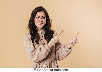 vingers, glimlachende vrouw, beeld, aantrekkelijk, wijzende, vrolijk, terzijde