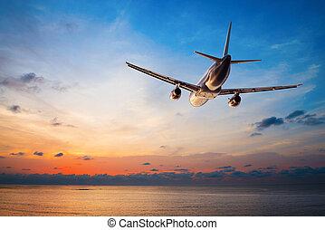 vliegen, vliegtuig zonsondergang