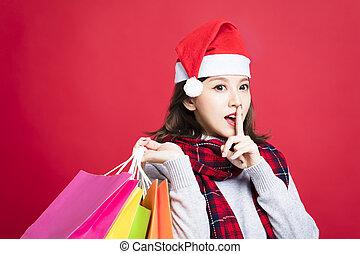 vrouw winkelen, jonge, kadootjes, geheim, kerstmis, gebaar