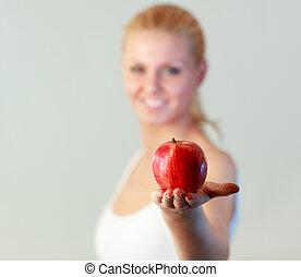 vrouwenholding, jonge, appel, brandpunt