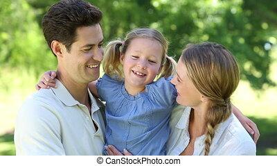 weinig; niet zo(veel), ouders, meisje, hun, vrolijke