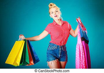 zakken, shoppen , meisje, pinup, jurkje, kopende kleren