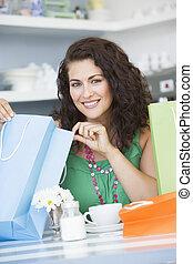 zakken, vrouw winkelen, zittende , jonge, koffiehuis